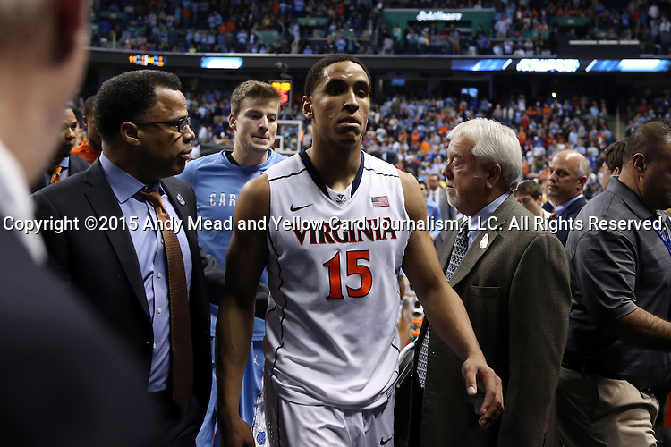 13 March 2015: Virginia's Malcolm Brogdon (15) walks off the court after the loss. The University of Virginia Cavaliers played the University of North Carolina Tar Heels in an NCAA Division I Men's basketball game at the Greensboro Coliseum in Greensboro, North Carolina in an ACC Men's Basketball Tournament semifinal game. North Carolina won the game 71-67.