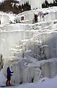 "22/01/13..Mark Procter (orange helmet) and David Pendlebury were the first pair to make the climb today...After many days below zero a giant waterfall has now frozen solid attracting climbers to tackle the huge 30 metre ascent up the freshly formed icicles and towers of ice. Known as Kinder Downfall the waterfall is the tallest in the Peak District. The river Kinder cascades over the top of the Kinder Scout plateau near the Pennine Way 2,087 ft above sea level mid-way between the villages of Hayfield and Edale in the High Peak of Derbyshire...Finding out when the waterfall is ready to climb is shrouded in secrecy. One of the six climbers who scaled the frozen spectacle today said: ""There's lots of misinformation on the internet, everyone wants to be the first to climb it as soon as it's in condition to climb""...The climb up to the face of the waterfall took many hours today with climbers trudging through waist-deep snow-drifts before strapping on their crampons and using ice axes to scale the Downfall...All Rights Reserved - F Stop Press.  www.fstoppress.com. Tel: +44 (0)1335 300098."