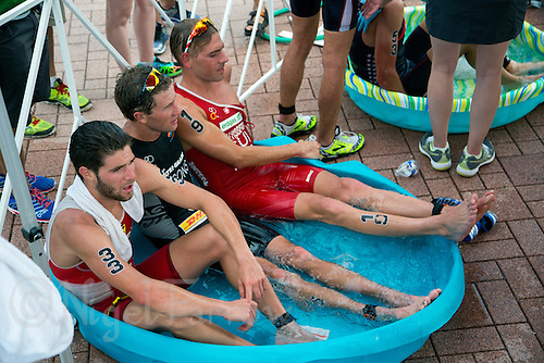 29 JUN 2014 - CHICAGO, USA - Alois Knabl (AUT) (left) of Austria, Ryan Sissons (NZL) (centre) of New Zealand and Andrea Salvisberg (SUI) (right) of Switzerland recover in a paddling pool ice bath after finishing the elite men's ITU 2014 World Triathlon Series round in Grant Park, Chicago in the USA (PHOTO COPYRIGHT © 2014 NIGEL FARROW, ALL RIGHTS RESERVED)
