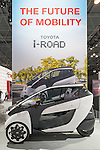 The Toyota i-ROAD three-wheeled two-seater fully electric vehicle is on display at the New York International Auto Show 2016, at the Jacob Javits Center. This car seats the two people in tandem. This was Press Preview Day one of NYIAS, and the Trade Show will be open to the public for ten days, March 25th through April 3rd.