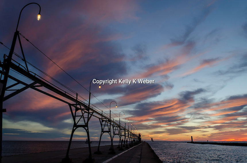 Colorful, whispy clouds decorate the sky at sunset over South Haven's Lake Michigan lake shore.