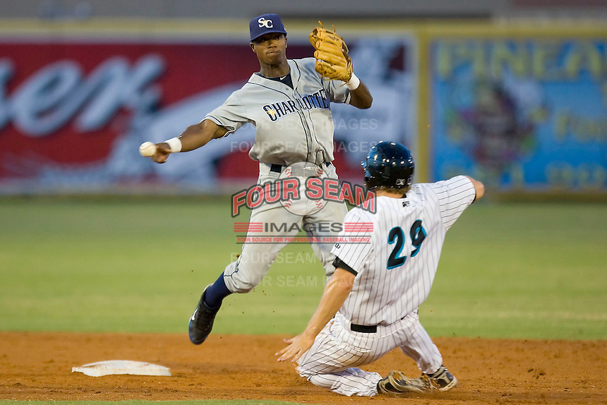 Shortstop Tim Beckham #22 of the Charlotte Stone Crabs tries to turn a double play as Ben Lasater #29 of the Jupiter Hammerheads slides into second base at Roger Dean Stadium June 16, 2010, in Jupiter, Florida.  Photo by Brian Westerholt /  Seam Images