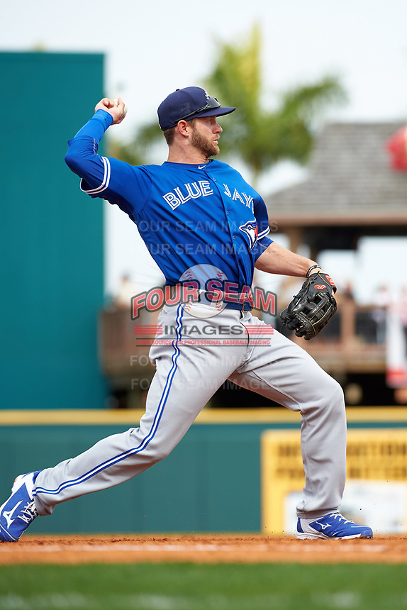 Toronto Blue Jays third baseman David Adams (7) throws to first during a Spring Training game against the Pittsburgh Pirates on March 3, 2016 at McKechnie Field in Bradenton, Florida.  Toronto defeated Pittsburgh 10-8.  (Mike Janes/Four Seam Images)