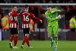Dean Henderson celebrates towards Billy Sharp and Oliver Norwood of Sheffield United  after the Premier League match at Bramall Lane, Sheffield. Picture date: 10th January 2020. Picture credit should read: James Wilson/Sportimage