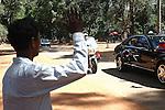 A man waves as King Norodom Sihamoni passes by in his motorcade at Angkor Wat, Cambodia. June 7, 2013.