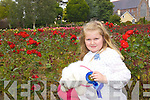 Soaking up the sun Feile na mBlath in Tralee Town Park on Saturday was Sophie Foran Monalee with her Bichon Frise dog called Cindy who won second prize at the dog dhow in the small dog category.