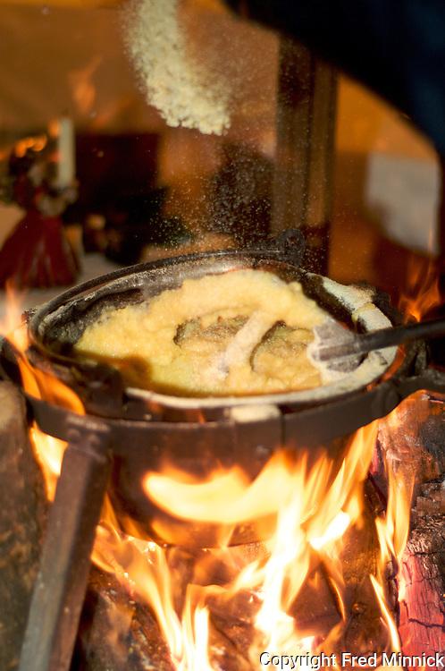 Polenta being made over an open fire at the La Subida restaurant in Collio, Italy. La Subida also makes its own balsamic vinegar