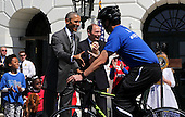 United States President Barack Obama (L) and Secretary of Veterans Affairs Robert McDonald (C) watch the Wounded Warrior Ride at the White House, in Washington, DC, April 14, 2016.  The event helps raise awareness to the public about severely injured veterans and provides rehabilitation opportunities. <br /> Credit: Aude Guerrucci / Pool via CNP