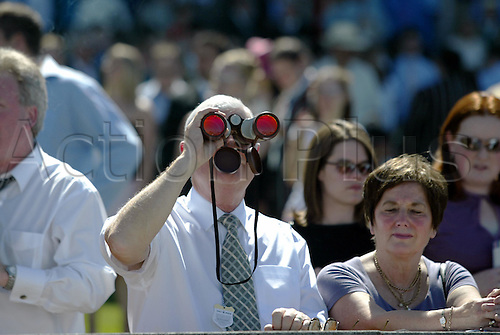 7 August 2004: A gentleman using binoculars to follow the action on The Blue Square Shergar Cup day at Ascot. Photo: Neil Tingle/action plus...horse racing 040807 crowd