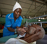 Nurse Nacima Keni examines a patient in the Mother of Mercy Hospital in Gidel, a village in the Nuba Mountains of Sudan. The area is controlled by the Sudan People's Liberation Movement-North, and frequently attacked by the military of Sudan. The Catholic hospital is the only referral hospital in the war-torn area.<br /> <br /> Keni is a 2015 graduate of the Catholic Health Training Institute, a school in Wau, South Sudan, sponsored by Solidarity with South Sudan.