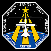 FILE: In this photo released by NASA in Houston, Texas on June 1, 2005, the STS-121 patch depicts the Space Shuttle docked with the International Space Station (ISS) in the foreground, overlaying the astronaut symbol with three gold columns and a gold star. The ISS is shown in the configuration that it will be in during the STS-121 mission. The background shows the nighttime Earth with a dawn breaking over the horizon. STS-121, ISS mission ULF1.1, is the final Shuttle Return to Flight test mission. This utilization and logistics flight will bring a multipurpose logistics module (MPLM) to the ISS with several thousand pounds of new supplies and experiments. In addition, some new orbital replacement units (ORUs) will be delivered and stowed externally on ISS on a special pallet. These ORUs are spares for critical machinery located on the outside of the ISS. During this mission the crew will also carry out testing of Shuttle inspection and repair hardware, as well as evaluate operational techniques and concepts for conducting on-orbit inspection and repair.<br /> The NASA insignia design for Shuttle space flights is reserved for use by the astronauts and other official use as the NASA Administrator may authorize. Public availability has been approved only in the form of illustrations by the various news media. When and if there is any change in this policy, which is not anticipated, such will be publicly announced.<br /> Credit: NASA via CNP
