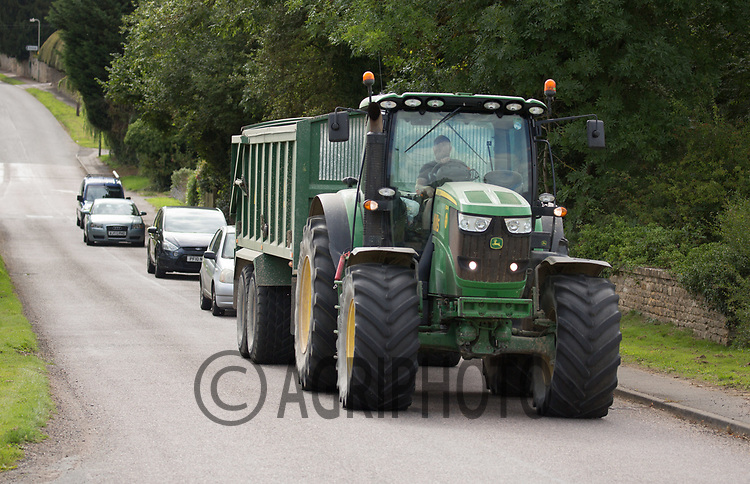 Tractor and trailer on a public road with que of cars behind it<br /> Picture Tim Scrivener 07850 303986<br /> &hellip;.covering agriculture in the UK&hellip;.