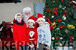 Local Children Sean, Isabella and Cillian Falvey with Santa after they turned on the lights in Ballybunion on Sunday evening.
