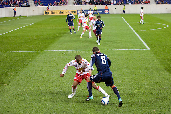 A New York Red Bull player fights for the ball with New England's Chris Tierney as the New York Red Bulls play their final match of the season against the New England Revolution at Red Bull Arena in Harrison, New Jersey on 21 October 2010.