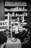 Warhol posing in his home on Madison Avenue in the 90's.