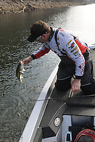 NWA Democrat-Gazette/FLIP PUTTHOFF <br /> A steep, rocky bank yielded a spotted bass that Bohannan caught with a crank bait.