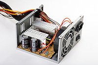 DESKTOP COMPUTER POWER SUPPLY<br /> (Variations Available)<br /> Showing Capacitors<br /> Also visible are the fan, resistors, transistors, capacitors and two heat sinks.