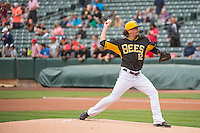 Zach Stewart (12) of the Salt Lake Bees delivers a pitch to the plate against the Colorado Springs Sky Sox in Pacific Coast League action at Smith's Ballpark on May 24, 2015 in Salt Lake City, Utah.  (Stephen Smith/Four Seam Images)
