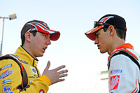 Feb 07, 2009; Daytona Beach, FL, USA; NASCAR Sprint Cup Series driver Kyle Busch (left) talks to teammate Joey Logano during practice for the Daytona 500 at Daytona International Speedway. Mandatory Credit: Mark J. Rebilas-