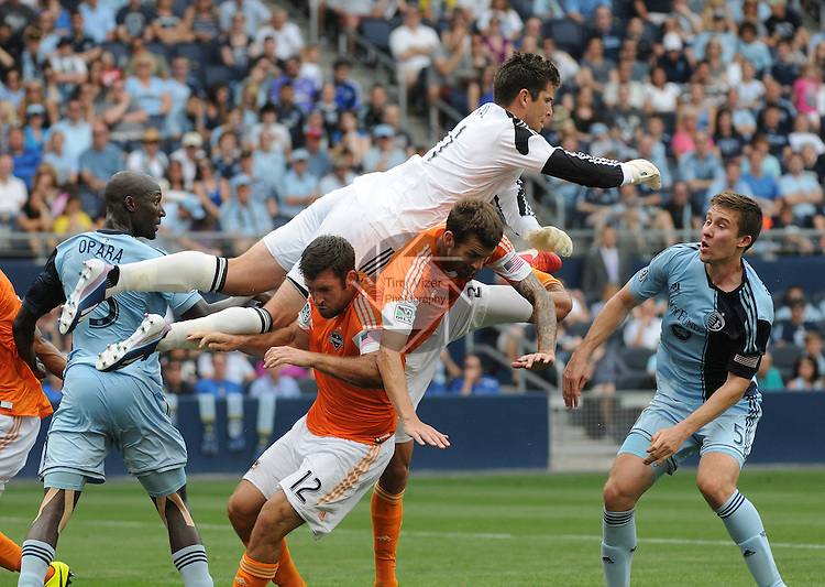 Football - Major League Soccer - Houston Dynamo at Sporting KC - The Sporting KC and the Houston Dynamo played to a 1-1 tie in regulation time at Sporting KC Park in Kansas City, Kansas, USA. Houston Dynamo goalkeeper Tally Hall (1, left) leaps over Houston Dynamo teammates forward Will Bruin (12) and defender Eric Brunner (2) to spike the ball on a corner kick late in the first half.  At far left is Sporting KC defender Ike Opara (3), and at far right is Sporting KC defender Matt Besler (5).