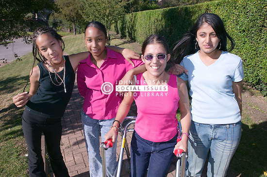 Group of teenaged friends out in the park together,