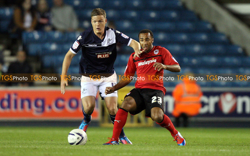 Nicky Maynard of Cardiff and Shane Lowry of Millwall - Millwall vs Cardiff City, nPower Championship at the New Den, Millwall, London - 18/09/12 - MANDATORY CREDIT: Rob Newell/TGSPHOTO - Self billing applies where appropriate - 0845 094 6026 - contact@tgsphoto.co.uk - NO UNPAID USE.