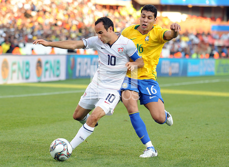Landon Donovan (10) of USA  controls the ball against Andre Santos (16) of Brazil. Brazil defeated USA 3-0 during the FIFA Confederations Cup at Loftus Versfeld Stadium in Tshwane/Pretoria, South Africa on June 18, 2009.