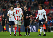 9th December 2017, Wembley Stadium, London England; EPL Premier League football, Tottenham Hotspur versus Stoke City; Referee Roger East warning Ryan Shawcross, the Stoke City captain with Dele Alli of Tottenham Hotspur and Ben Davies of Tottenham Hotspur looking on