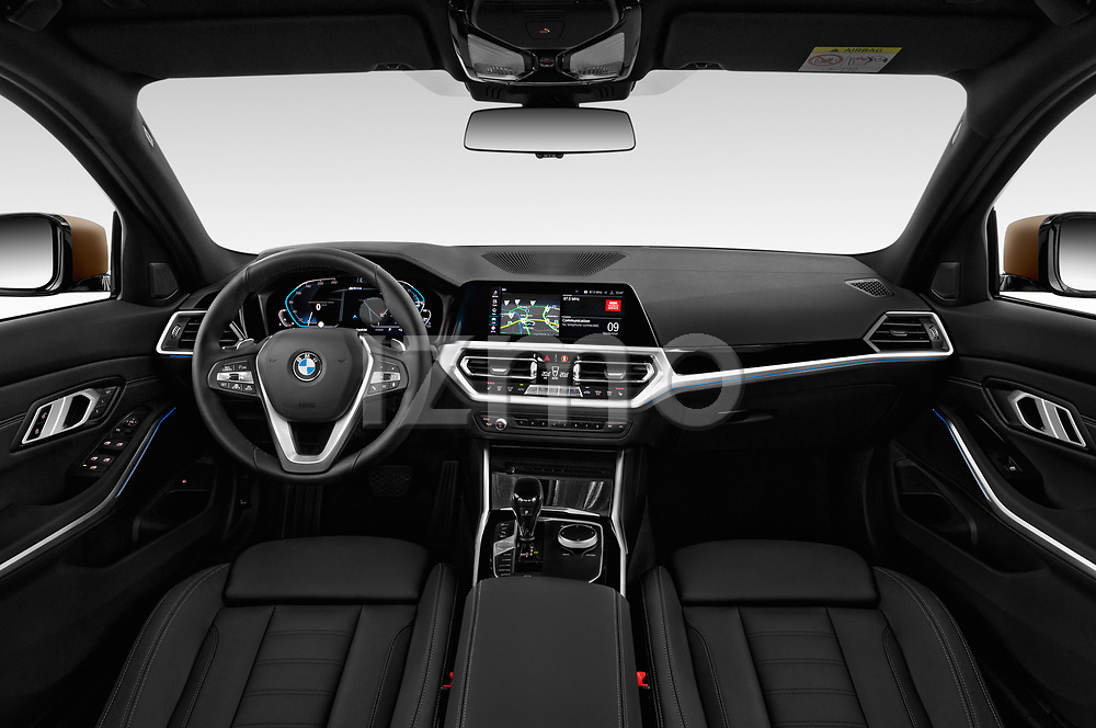 Stock photo of straight dashboard view of a 2019 BMW 3 Series Sport PHEV 4 Door Sedan