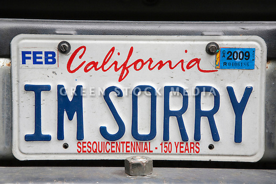 A rear view of a Ford Explorer SUV car with an 'I'm Sorry' license plate. San Francisco, California, USA