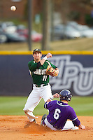 Charlotte 49ers second baseman Matt Creech (11) makes a throw to first base as Devin Bujnovsky (6) of the High Point Panthers attempts to break up a double-play at Willard Stadium on February 20, 2013 in High Point, North Carolina.  The 49ers defeated the Panthers 12-3.  (Brian Westerholt/Four Seam Images)
