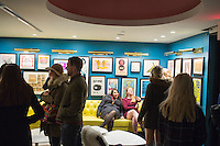 "People gather in the lobby of  The Verb Hotel in the Fenway neighborhood of Boston, Massachusetts, USA, on Friday, Dec. 4, 2015. The hotel is considered a ""boutique hotel"" and has collections on display throughout the premises of music memorabilia from the Boston area."