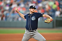 Starting pitcher Bryan Baker (33) of the Asheville Tourists in a game against the Greenville Drive on Tuesday, May 2, 2017, at Fluor Field at the West End in Greenville, South Carolina. Asheville won, 7-1. (Tom Priddy/Four Seam Images)
