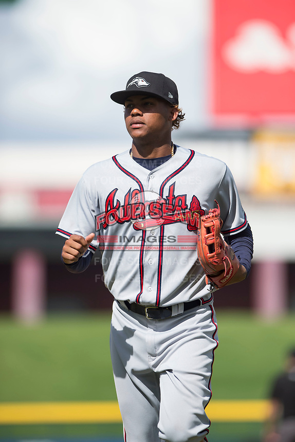 Peoria Javelinas center fielder Cristian Pache (27), of the Atlanta Braves organization, jogs off the field between innings of an Arizona Fall League game against the Mesa Solar Sox at Sloan Park on October 11, 2018 in Mesa, Arizona. Mesa defeated Peoria 10-9. (Zachary Lucy/Four Seam Images)