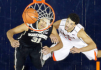 Wake Forest center Andre Washington (31) looks for the rebound with Virginia forward Anthony Gill (13) during the game Wednesday Jan. 08, 2014 in Charlottesville, Va. Virginia defeated Wake Forest 74-51.