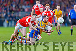 Padraig Doona Beaufort gets his pass away under pressure from Sean Howard Dromtarriffe during the Munster Junior final in Mallow on Sunday