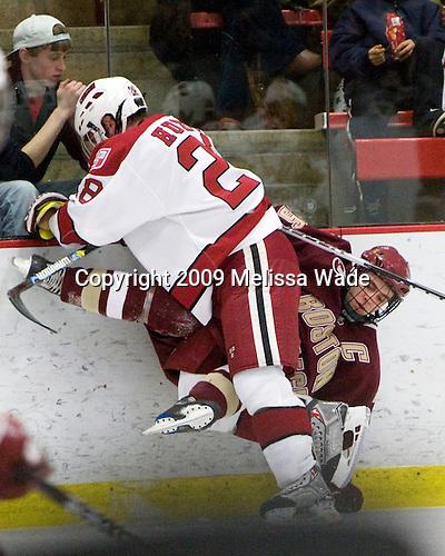 Chris Huxley (Harvard - 28), Matt Price (BC - 25) - The Boston College Eagles defeated the Harvard University Crimson 3-2 on Wednesday, December 9, 2009, at Bright Hockey Center in Cambridge, Massachusetts.