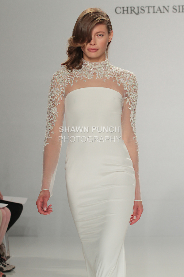 Model walks runway in an embroidered sleeve column gown, from the Christian Siriano for Kleinfeld bridal collection, at Kleinfeld on April 18, 2016 during New York Bridal Fashion Week Spring Summer 2017.
