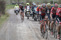 a mud-covered Greg Van Avermaet (BEL/BMC) working in an elite group mid-race<br /> <br /> 11th Strade Bianche 2017