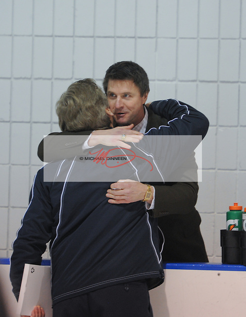 Eagle River coach Bill Comer and Chugiak coach Rod Wild embrace after the Mustangs' championship win at Ben Boeke Arena Saturday, February 6, 2016.  Photo for the Star by Michael DInneen