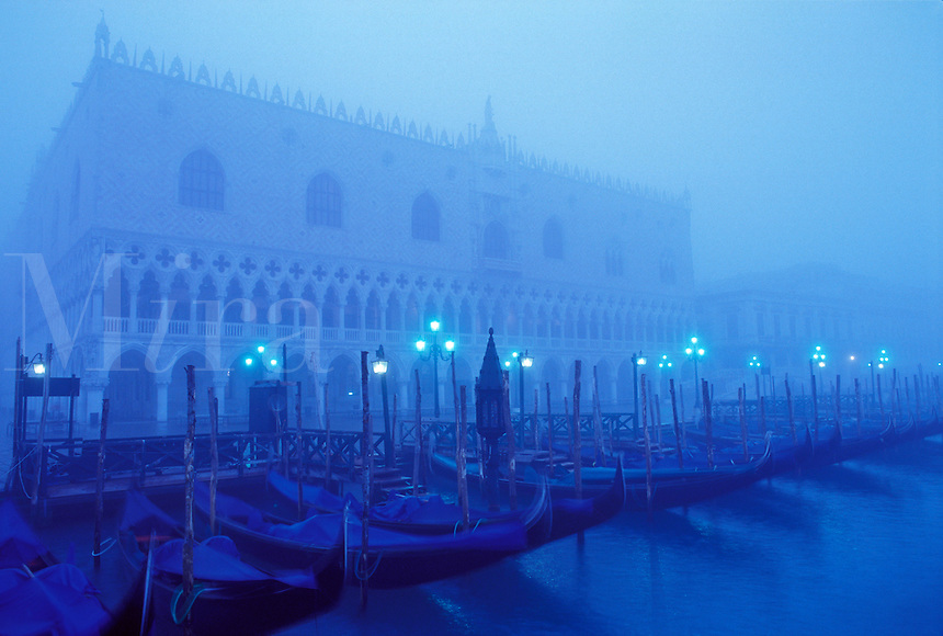 Italy, Venice, Molo San Marco and the Doge's Palace with gondolas in the early morning fog