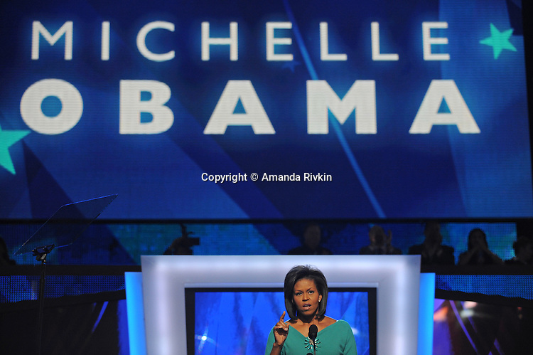 Michelle Obama, wife of presumptive Democratic nominee Barack Obama, addresses the Democratic National Convention at the Pepsi Center in Denver, Colorado on August 25, 2008.