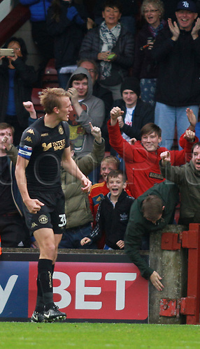 7th October 2017, Glanford Park, Scunthorpe, England; EFL League One football, Scunthorpe versus Wigan; Dan Burn of Wigan Athletic celebrates with the Wigan fans after he scored in the 51st minute to make it 0-1