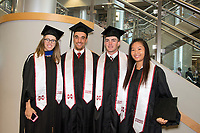 Students getting ready for graduation in Mize Pavilion.<br />  (photo by Beth Wynn / &copy; Mississippi State University)