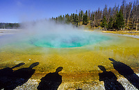 Morning Glory pool with shadows of tourists in Yellowstone national Park, Wyoming, USA