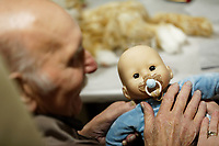 Pictured: John Williams.  Thursday 12 December 2019<br /> Re: Realistic looking baby dolls used for therapy at the Oaklands Day Centre in Rhymney near Tredegar south Wales, UK.