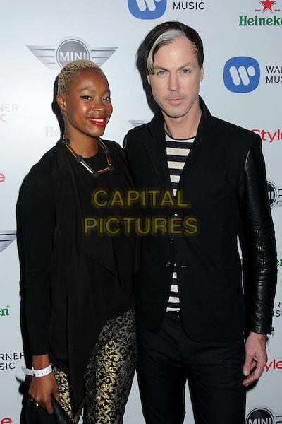 Noelle Scaggs, Michael Fitzpatrick, Fitz and The Tantrums.Warner Music Group 2013 Grammy Celebration held at The Chateau Marmont, West Hollywood, California, USA>.February 10th, 2013.half length black gold trousers suit stripe top white   .CAP/ADM/BP.©Byron Purvis/AdMedia/Capital Pictures.