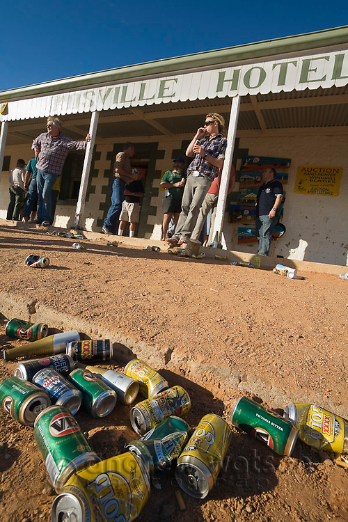 Empty beer cans outside the Birdsville Hotel during the annual Birdsville horse races.  Every September the small outback town hosts thousands of visitors for the Birdsville Cup, one of the most famous horse racing carnivals in Australia.  Birdsville, Queensland, AUSTRALIA.