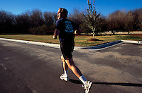 11 Jan 2000, South Carolina, USA --- George W. Bush takes a break from his presidential campaign by going jogging. Bush won the 2000 Presidential Election against Vice President Al Gore after a controversial vote recount in Florida. --- Image by © Brooks Kraft/Sygma/Corbis