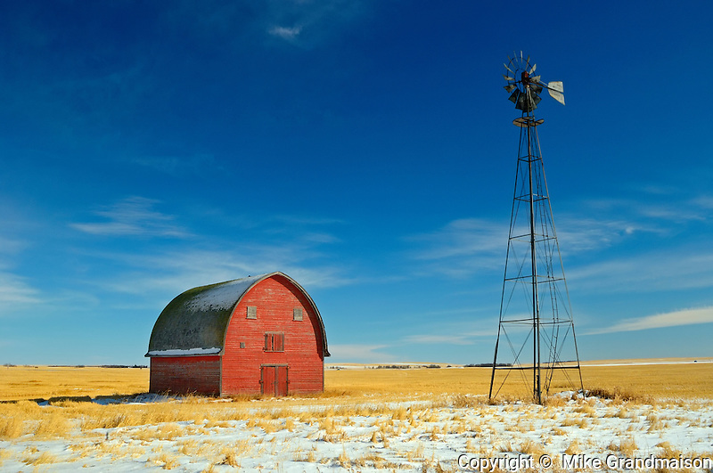 Red barn and windmill<br /> Vulcan<br /> Alberta<br /> Canada